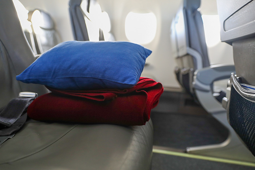 sleeping on planes 13 tips to make it