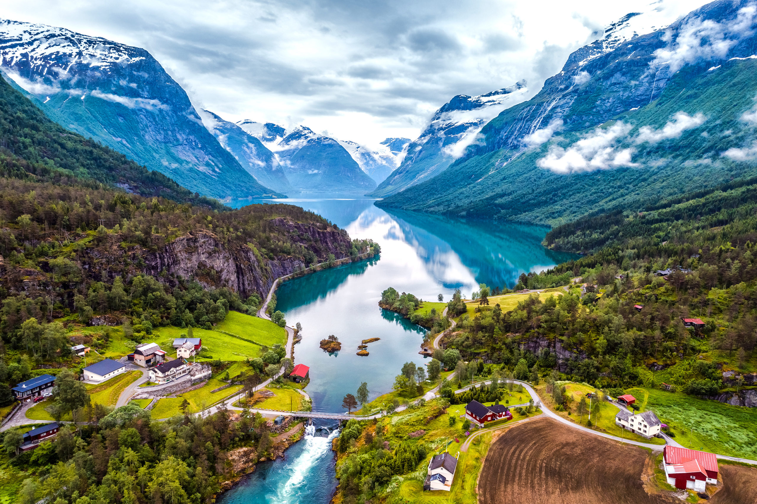 A small town in front of the mountains of Norway
