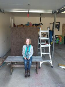My daughter demonstrating my set-up in the messy garage.