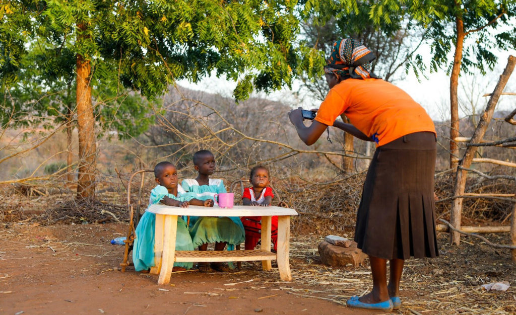 USING PHOTOVOICE TO ASSESS IMPACTS OF BEHAVIOR CHANGE NUTRITION ACTIVITIES IN KENYA