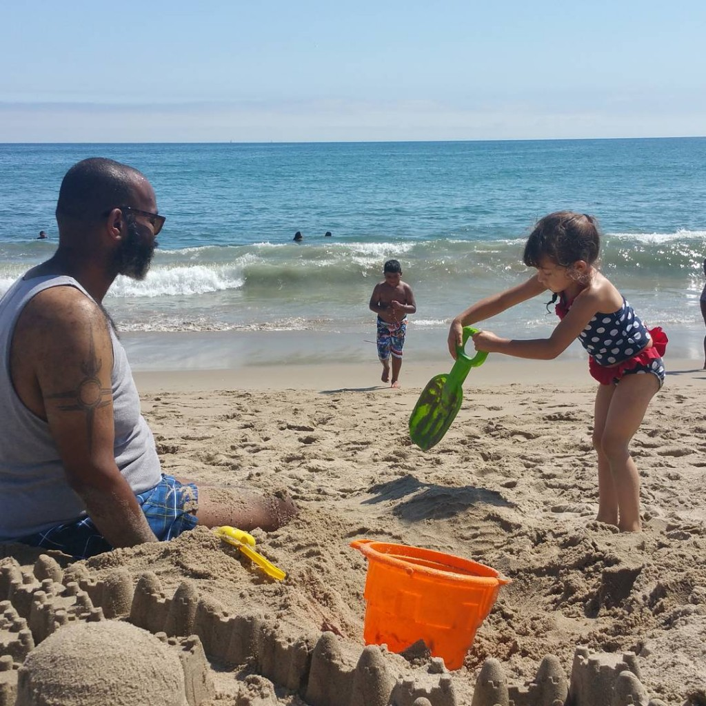 Living the life: beach + sand castles + burying your uncle. What's your fave beach thing to do: build sand castles or bury each other in the sand? #beach #malibu #familytime