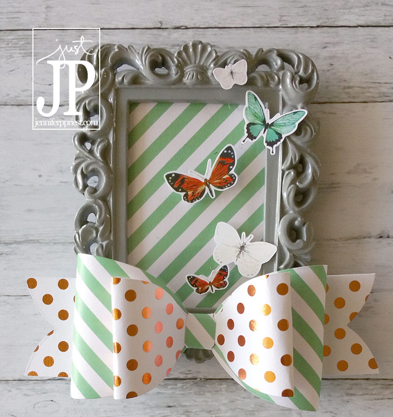 Create pretty altered frames with $1 frames from Michael's. Use paper embellishments you can remove to use elsewhere and attach magnets to the back to make these frames into functional magnets. Full video tutorial on this blog post associated with this photo - by Jennifer Priest