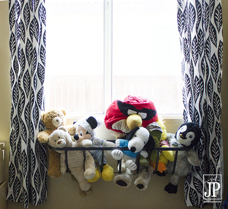 Use a window flower box to hold stuffed toys inside the house.