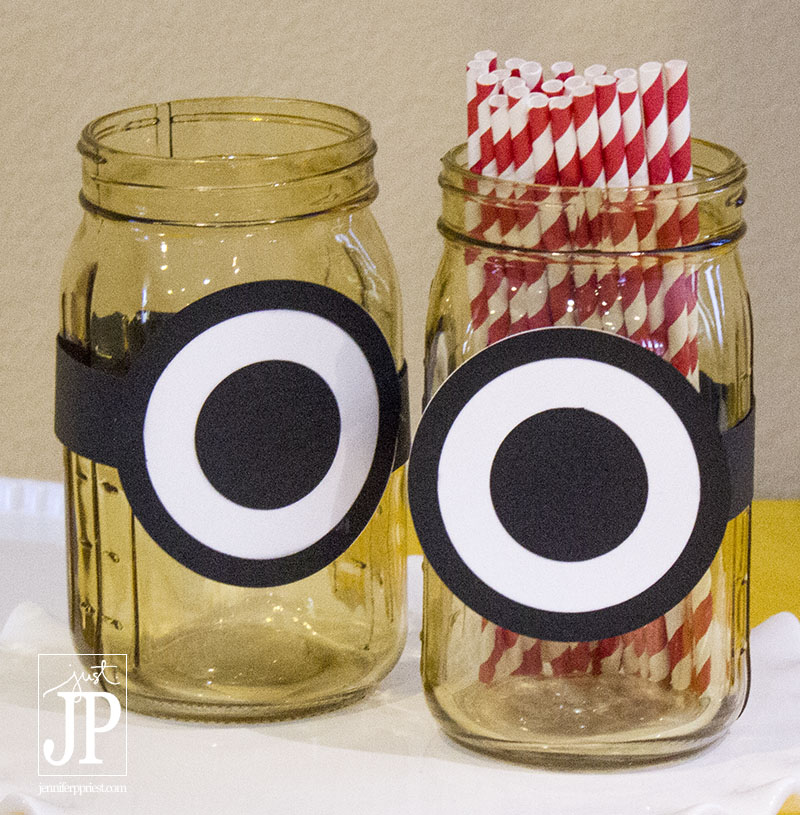 Make Minions Mason Jars for Party Decor using yellow mason jars from Darice and the Sizzix eclips2 to cut the eyes. Project and tutorial by jenniferppriest..com Jennifer Priest