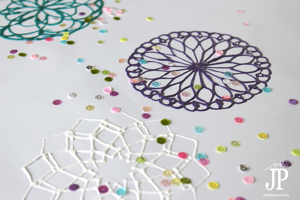 Make DIY Puffy Paint Doilies with Mandala patterns printed from the internet. Jennifer Priest shares an EASY tutorial - these make great window clings too!