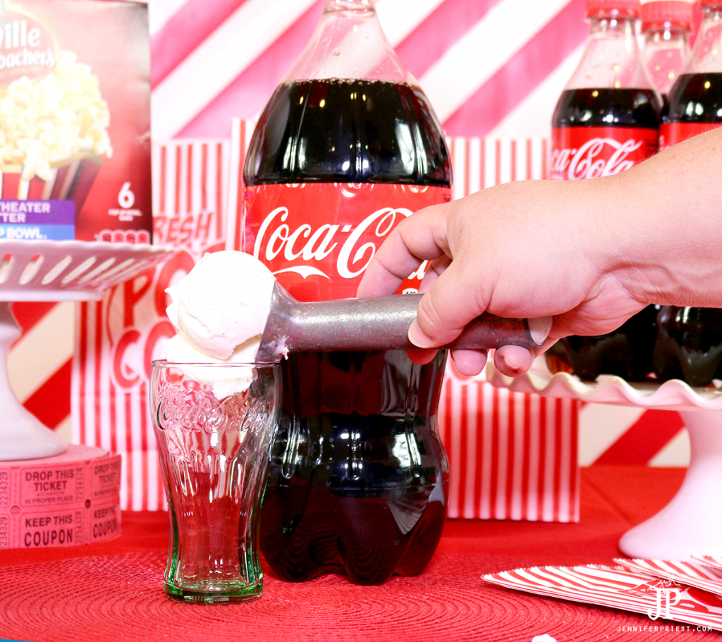 Scoop-vanilla-ice-cream-into-Coca-Cola-glasses-to-make-Coca-Cola-floats-for-movie-night