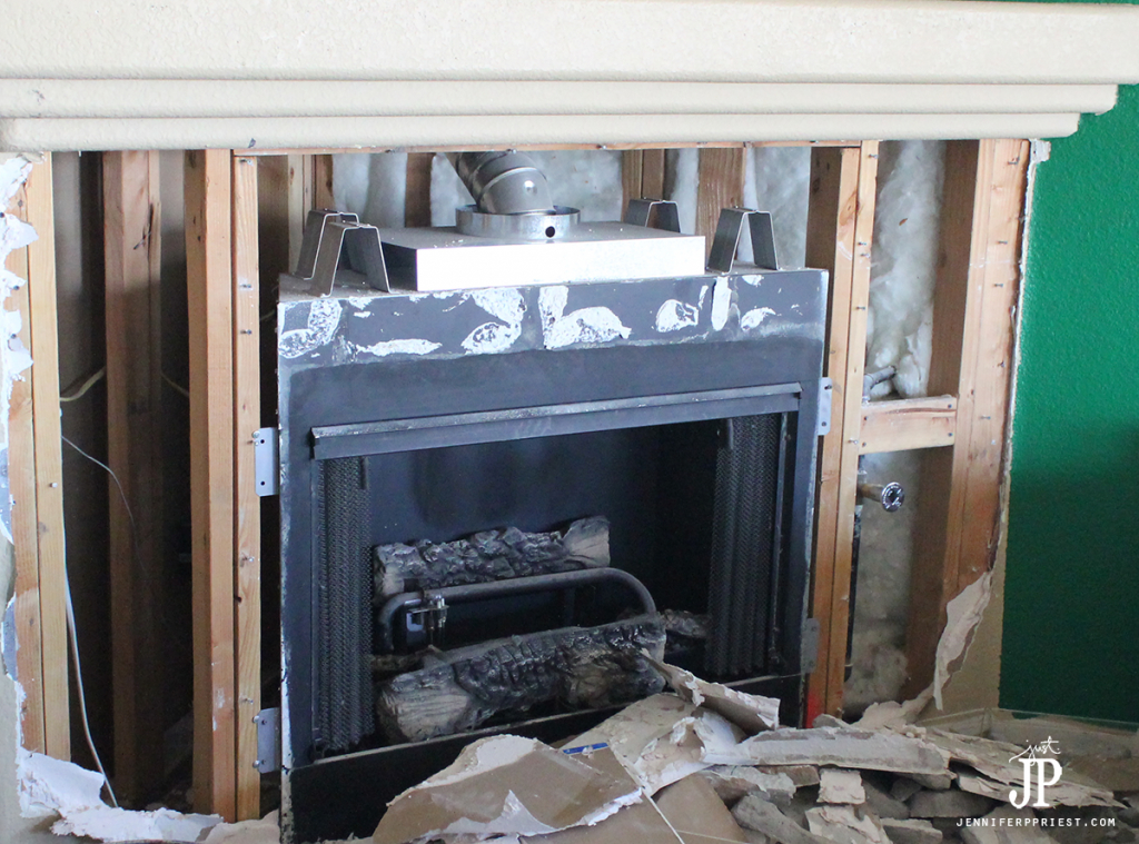 Fireplace-after-drywall-and-stone-demo-is-complete---jenniferppriest