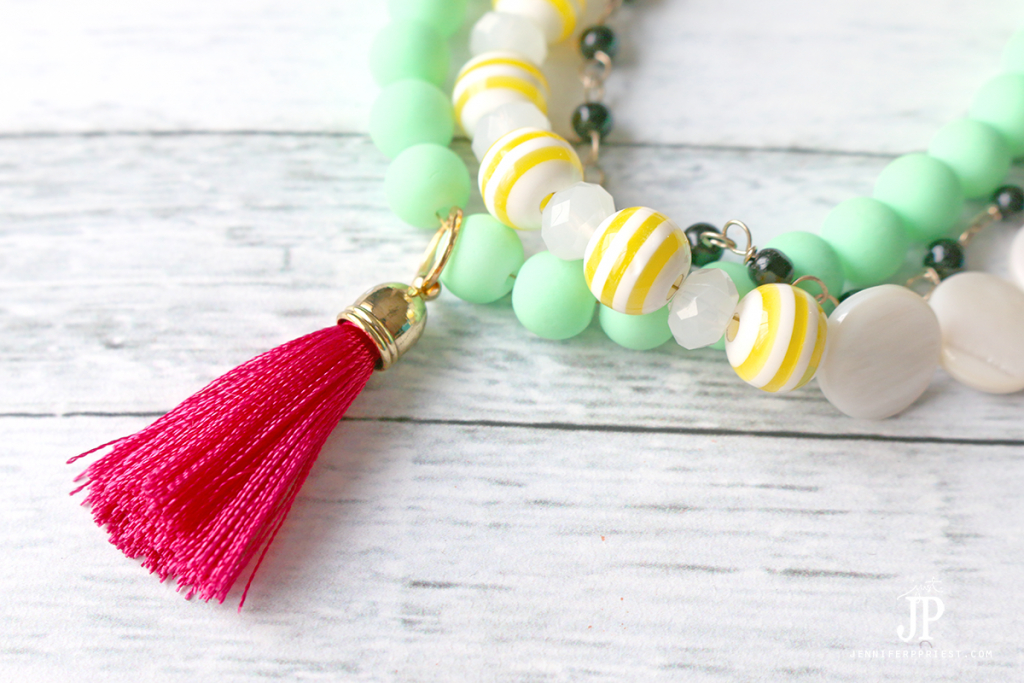 Tassels are easy to add to bracelets - just use a jump ring! See the tutorial on how to make this bracelet plus two more summer jewelry looks.