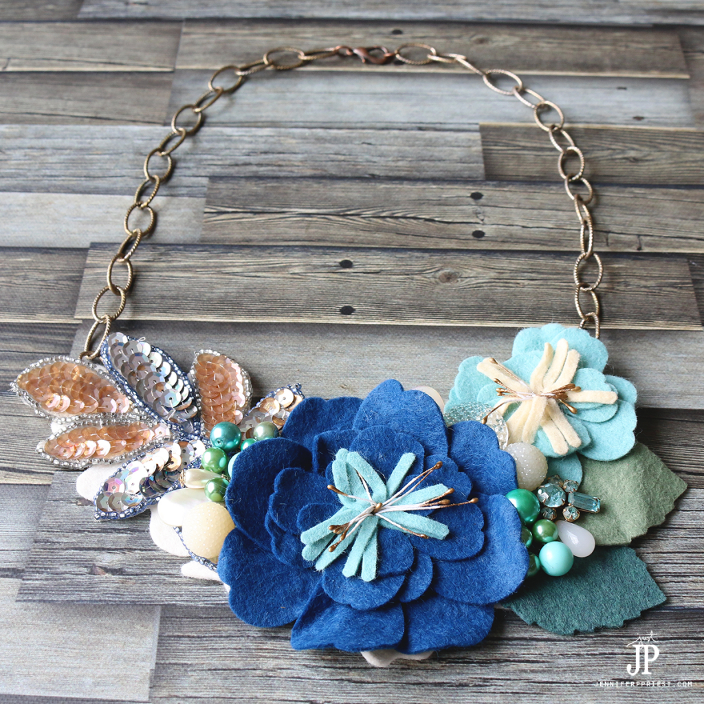 Turn die cut flowers and broken vintage jewelry into a gorgeous bib style necklace. NO jewelry skills needed - watch the video tutorial to see how!