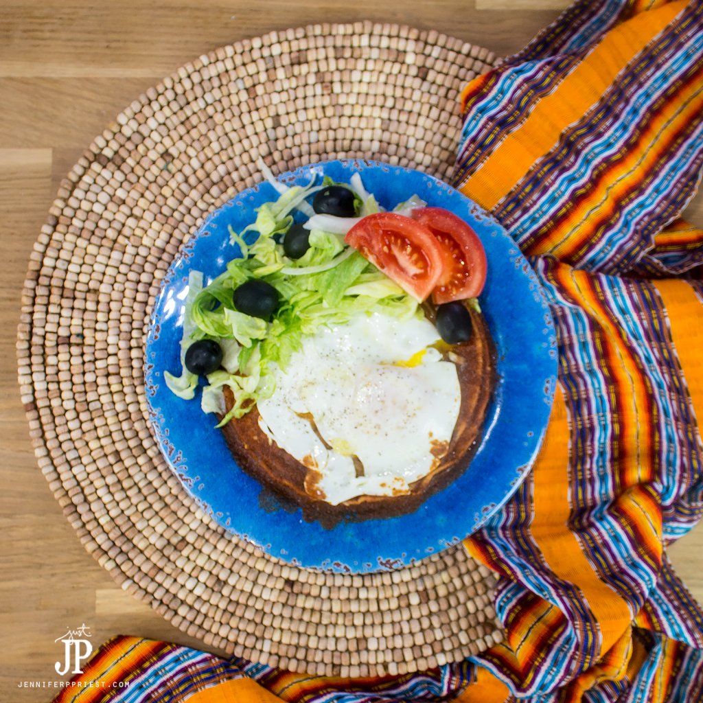 New Mexico style flat enchiladas topped with an egg
