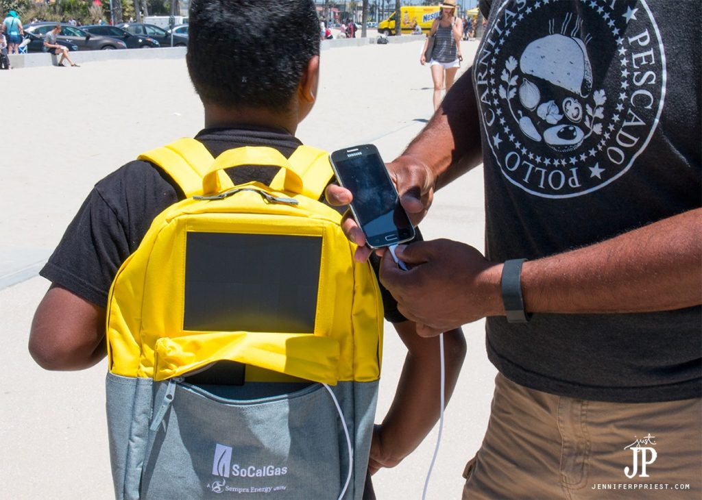 Use a solar backpack to keep electronics charged on the beach or when camping.