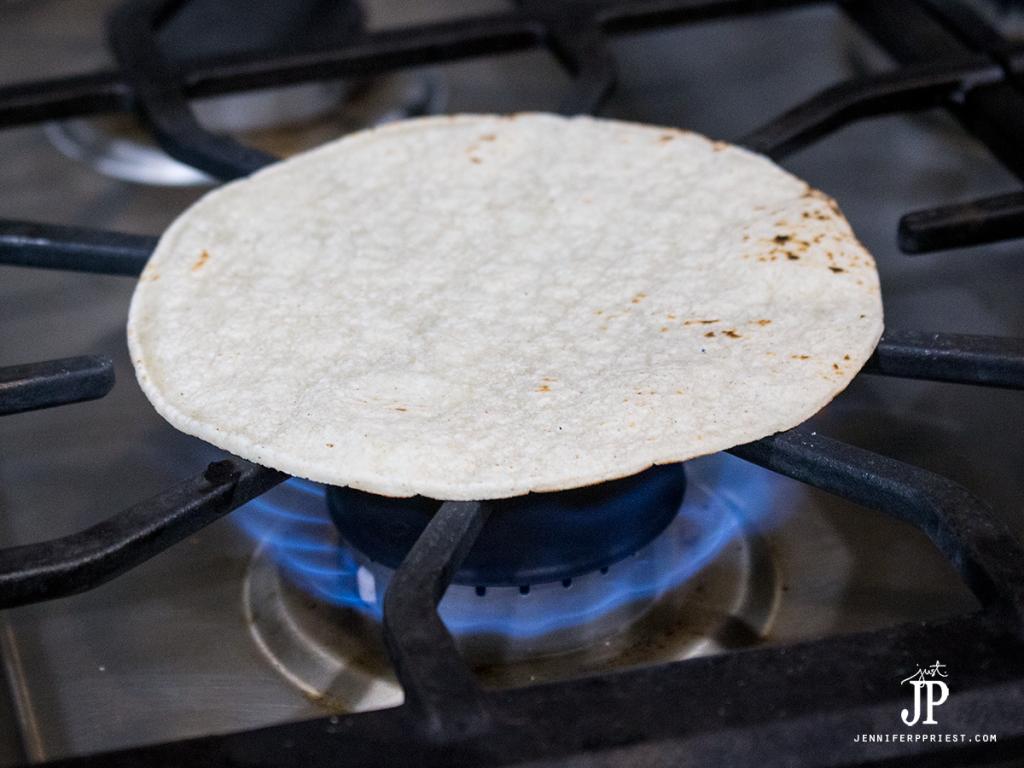 Warm tortillas to soften - Mexican Street Taco recipe with slow cooker pork by Jenniferppriest.com