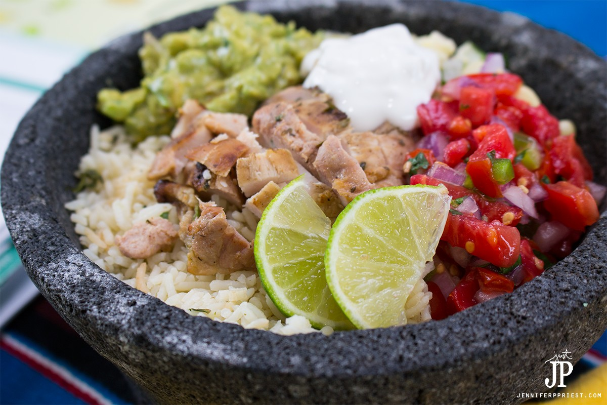 Chicken burrito bowl recipe - make it at home! Healthy burrito bowl PLUS creamy guacamole that you don't have to to pay EXTRA for!