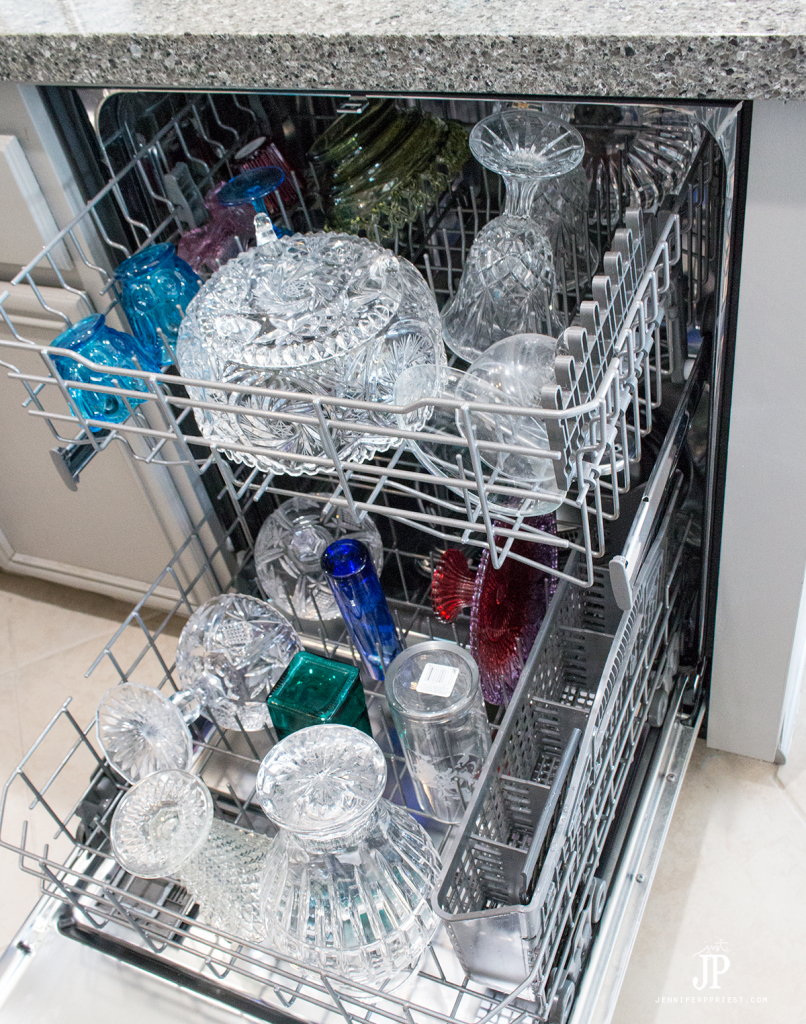 Wash crystal and glass in the dishwasher when deep cleaning your curio cabinet. #PledgeReflectionOfYou [AD] How to clean: Curio Cabinet - curio cabinets can be modern and a source of pride in your home. See how to use Pledge® Multi Surface to clean curio cabinet by Jennifer Priest https://www.smartfundiy.com/how-to-clean-curio-cabinet/