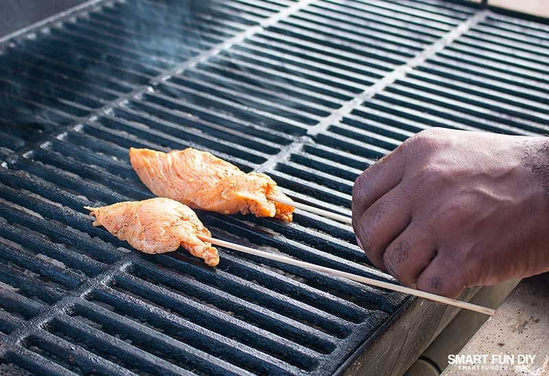 raw chicken skewers on grill