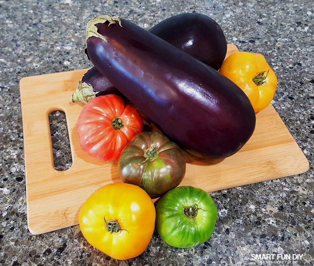 Heirloom tomatoes and eggplant. Grilled eggplant and heirloom tomato salad recipe https://www.smartfundiy.com/mothers-day-lunch-grilled-eggplant/ #SoWorthIt