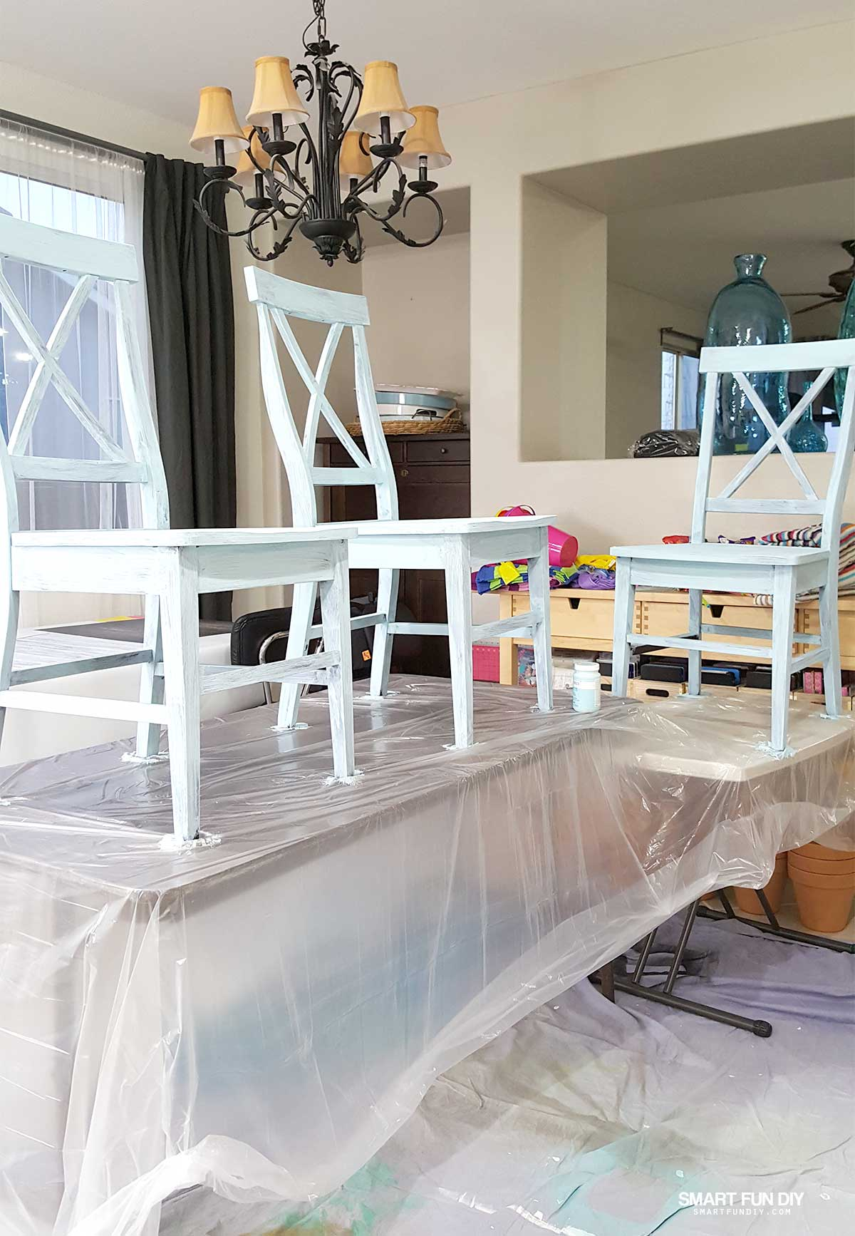 to paint inside spread a dropcloth over the floor and surrounding area and set the table on top we covered folding tables with plastic sheeting and then