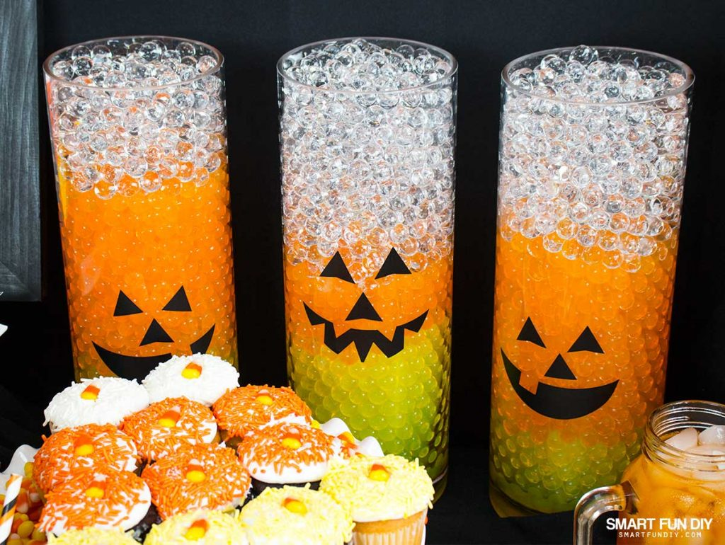 Throw a CANDY CORN Halloween party this year! make decor like these candy corn vases with water beads from GEMNIQUE.