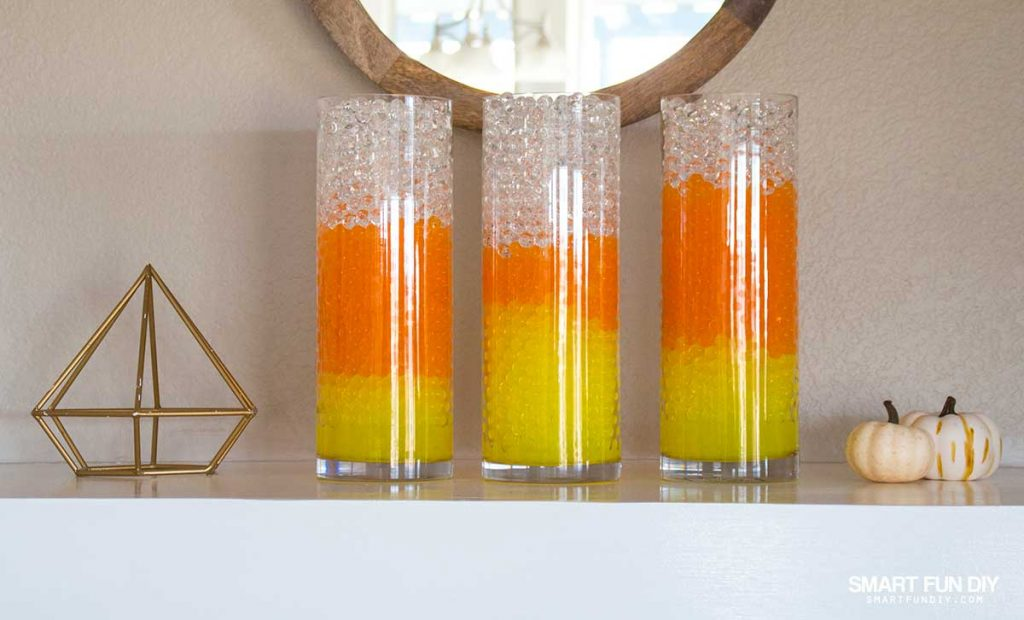 DIY Candy Corn Vases! Halloween Decor is easy with GEMNIQUE Water Beads. See how to make this display for under $15!