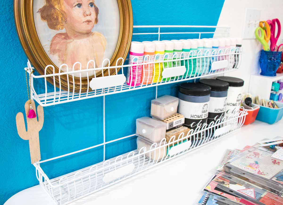 paint storage in vintage wire rack on craft table
