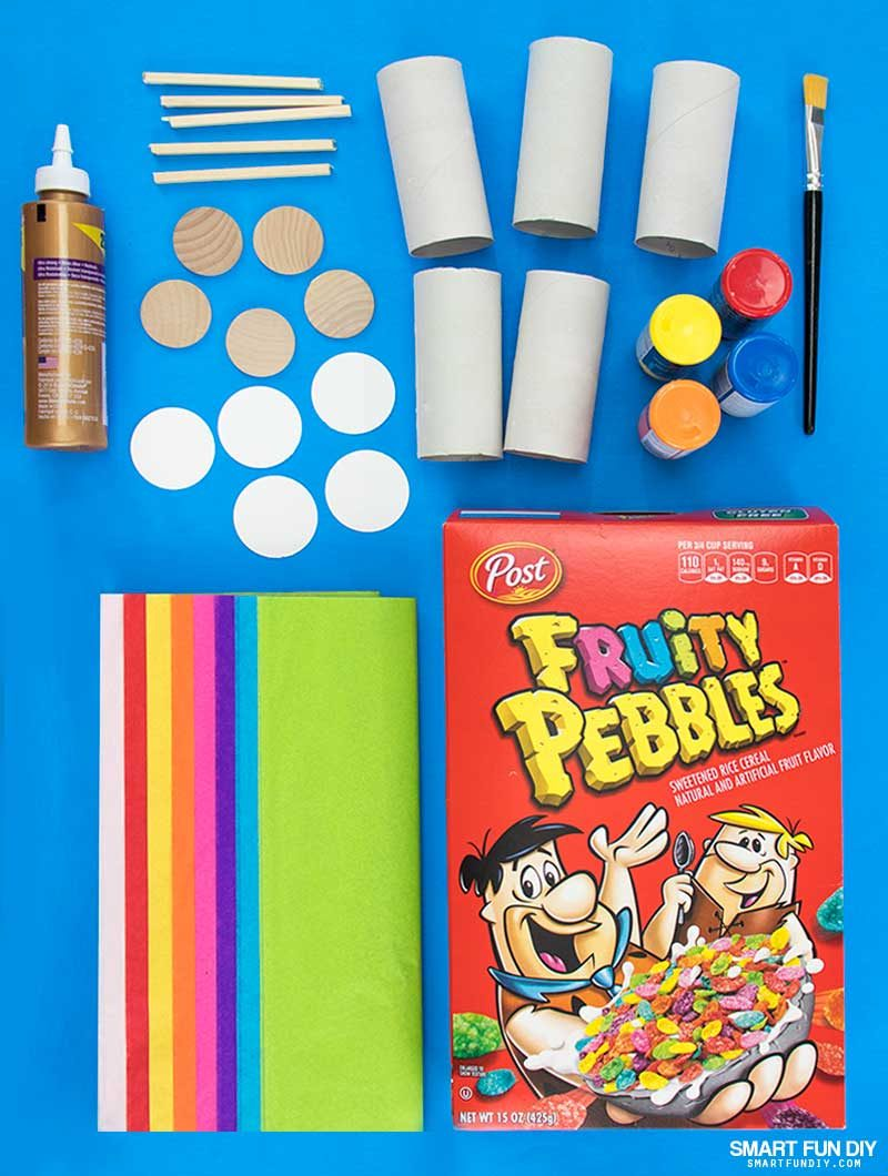 Supplies to make DIY confetti poppers covered with tissue paper and filled with Fruity Pebbles Cereal