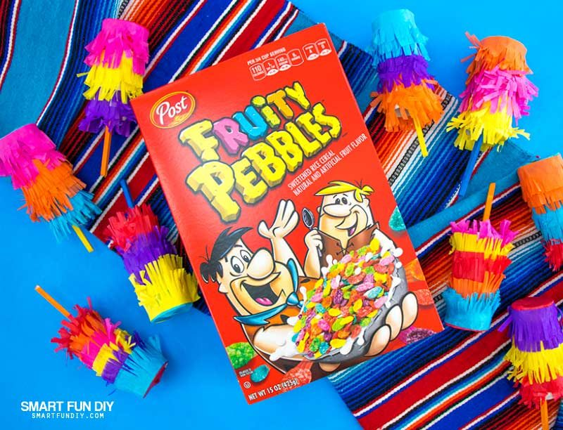Box of Fruity Pebbles cereal with DIY confetti poppers covered with tissue paper
