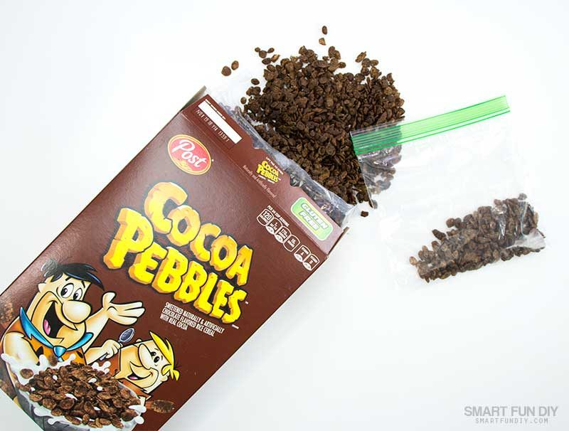 place cocoa pebbles cereal into zip top bag and crush into powder