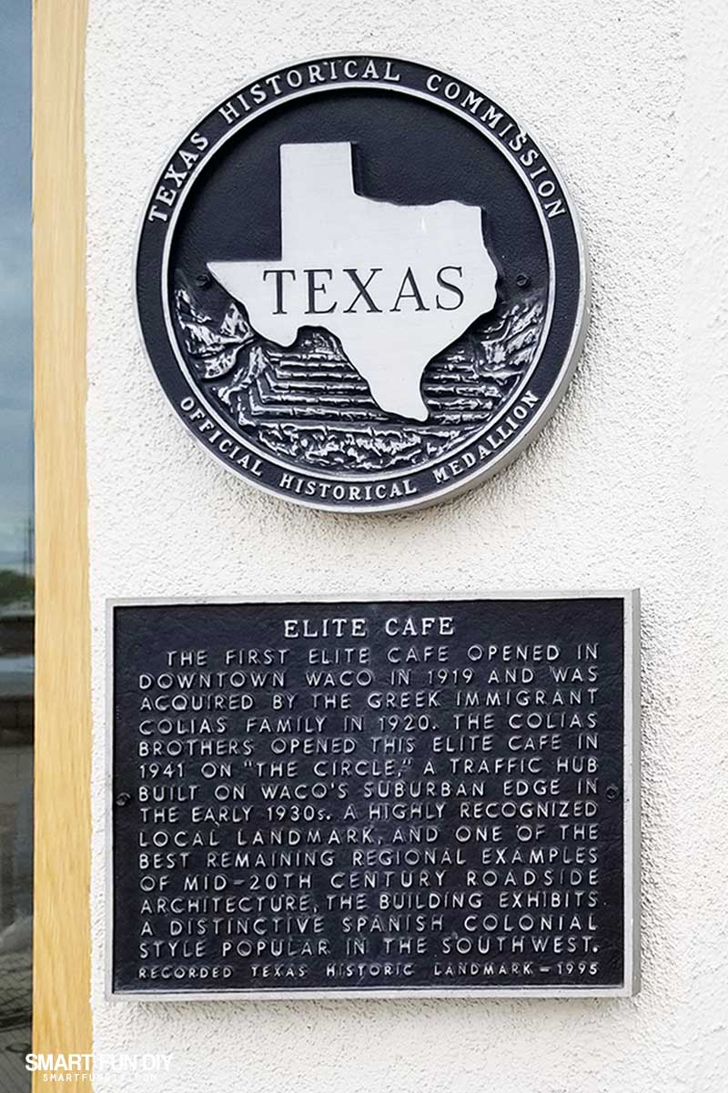Elite Cafe sign and historical Texas sign on Magnolia Table restaurant