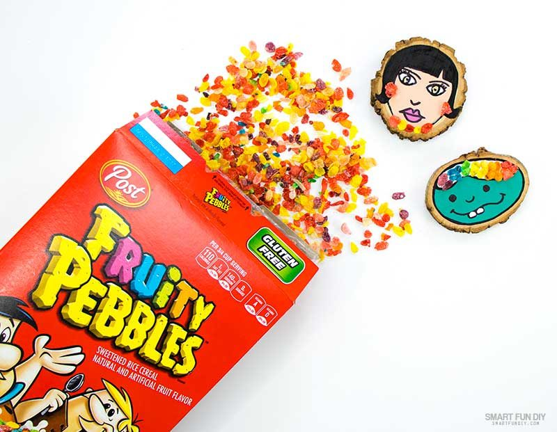 place whole piees of fruity pebbles cereal onto glue on wood slice