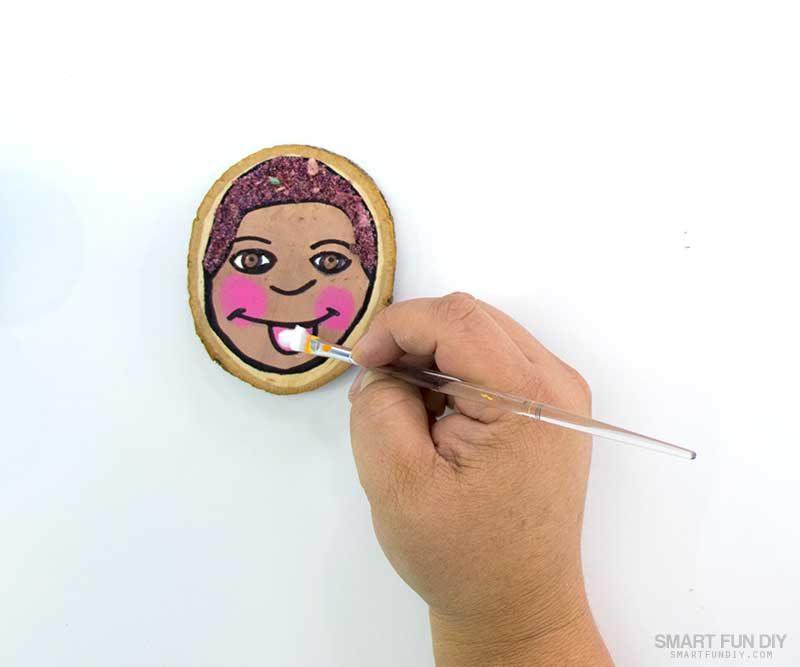 paint glue onto parts of the self portrait