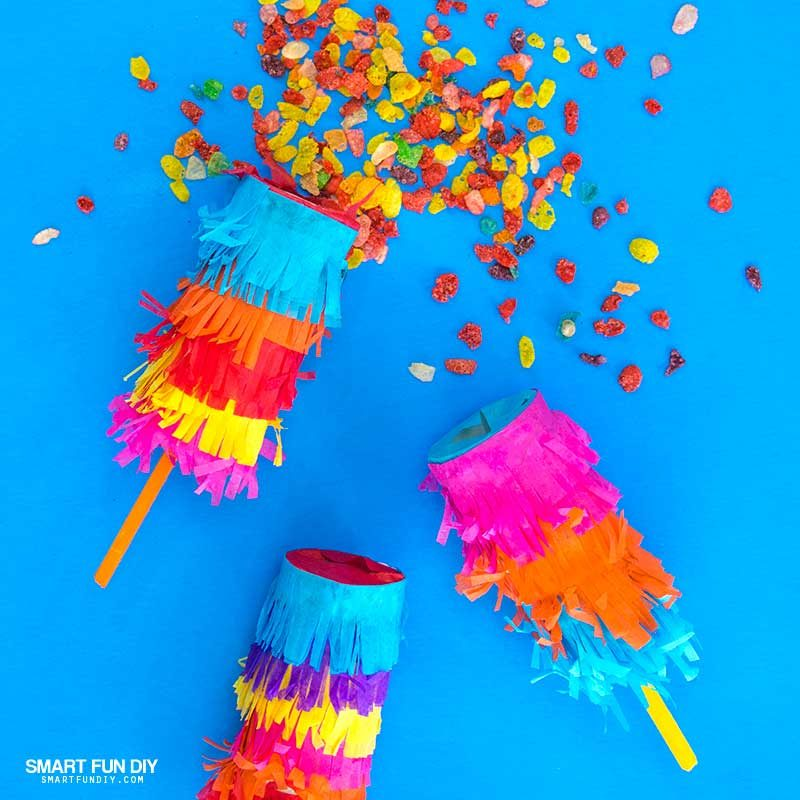 DIY confetti poppers covered with tissue paper and filled with Fruity Pebbles Cereal