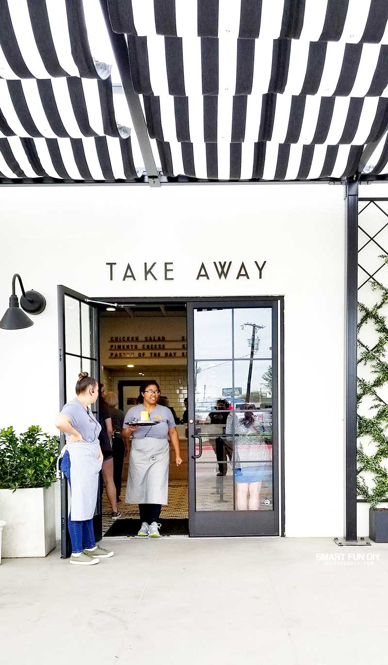 Door to Take Away market at Magnolia Table restaurant