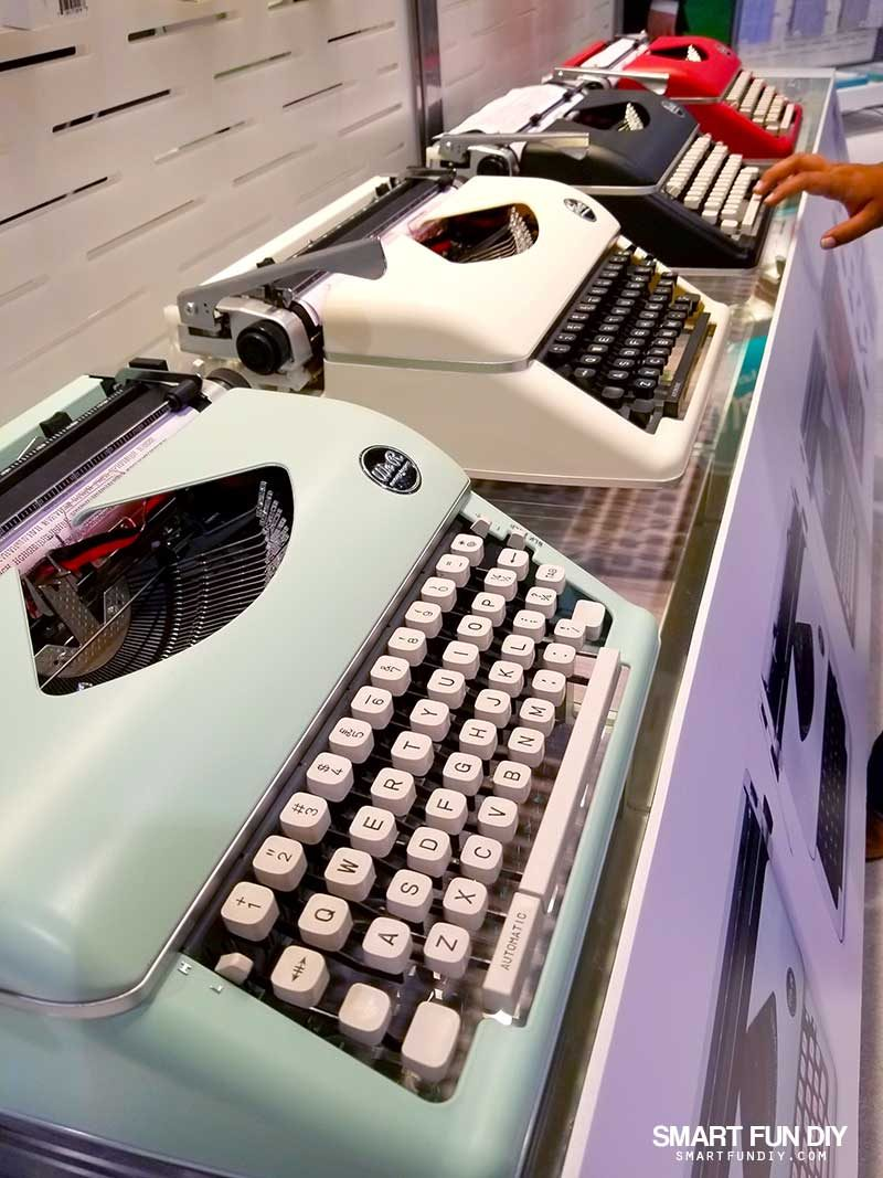 Colorful typewriters at WeRMemoryKeepers' 2018 Creativation booth