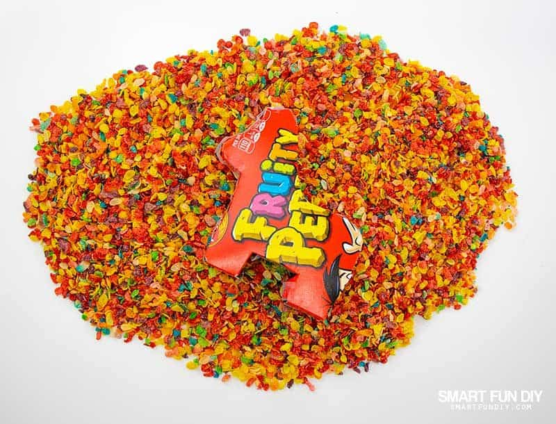 Pile of Fruity Pebbles cereal with DIY Pinata laying on top