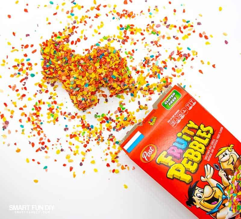 DIY pinata from cardboard covered in Fruity Pebbles cereal