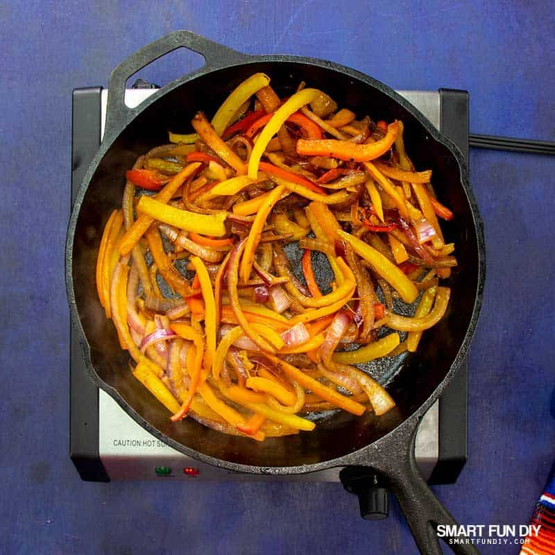 cooking fajita vegetables in pan
