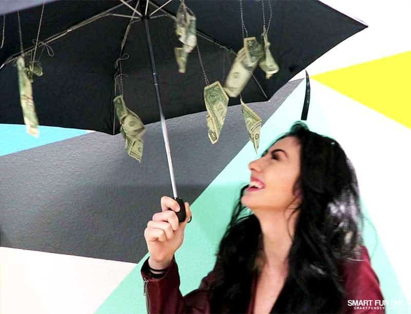 girl reacts to umbrella make it rain money gift idea