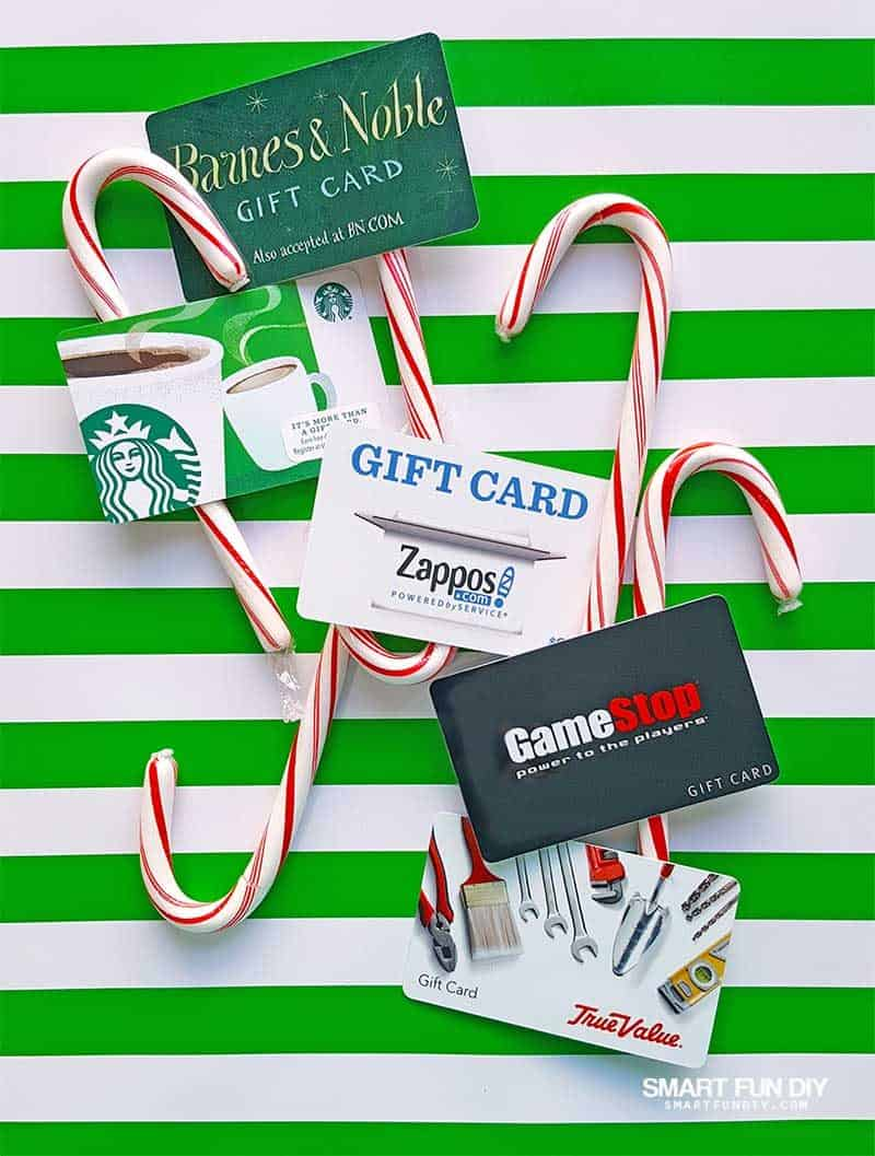 gift cards and candy canes on green strip background