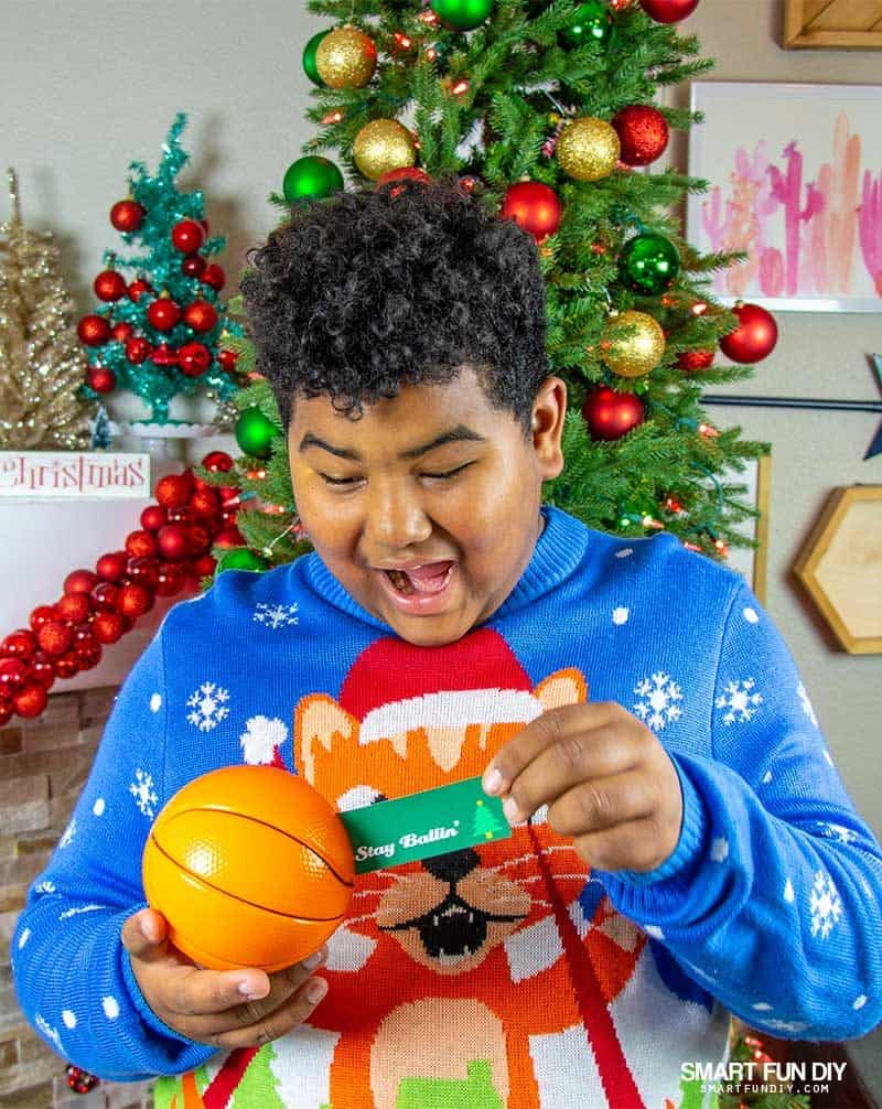 kid opening basketball with hidden gift card idea