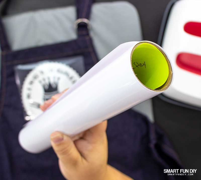 Roll of heat transfer vinyl with sticky note inside the roll