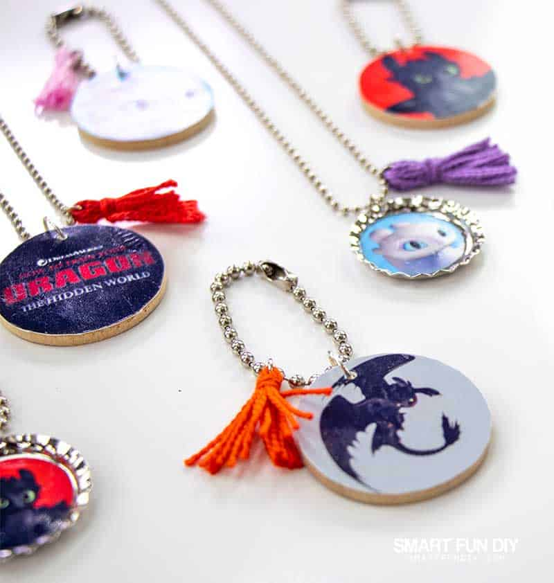 Array of keychains and necklaces made with How to Train Your Dragon movie printables