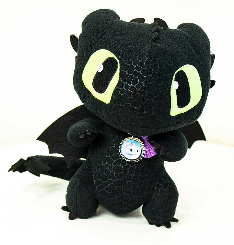 Toothless dragon plush wearing bottlecap necklace made with How to Train Your Dragon movie printables