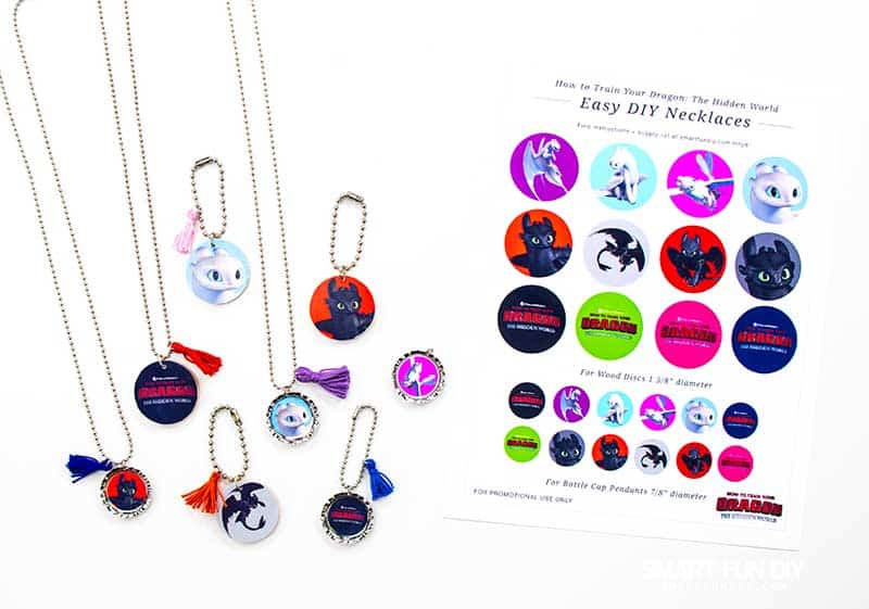 Array of necklaces and keychains and How to Train Your Dragon printables