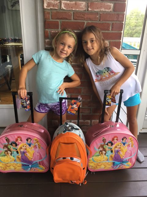 girls with suitcases ready to go to Disney