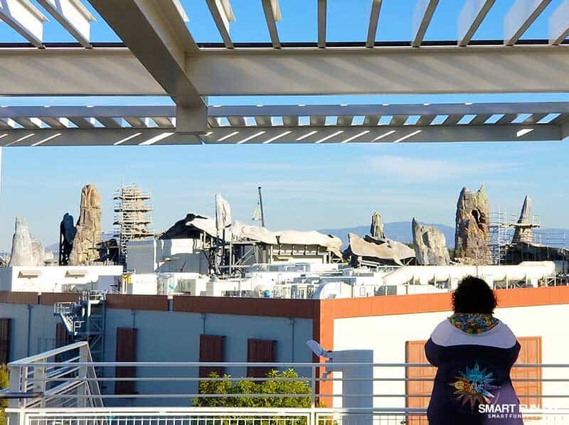 woman looking at Star Wars Galaxy's Edge construction from Mickey and Friends Parking Structure at Disneyland