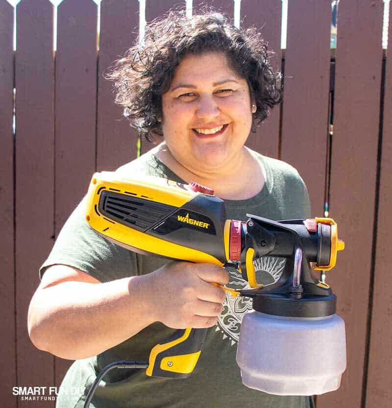 Woman holding Wagner Flexio Sprayer