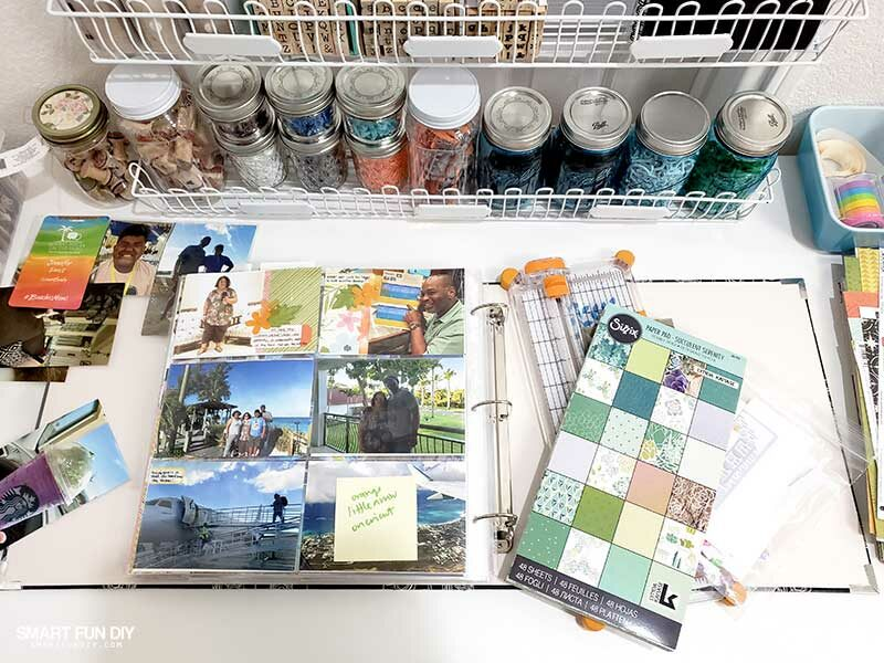scrapbooking supplies and project life scrapbook page on craft room table