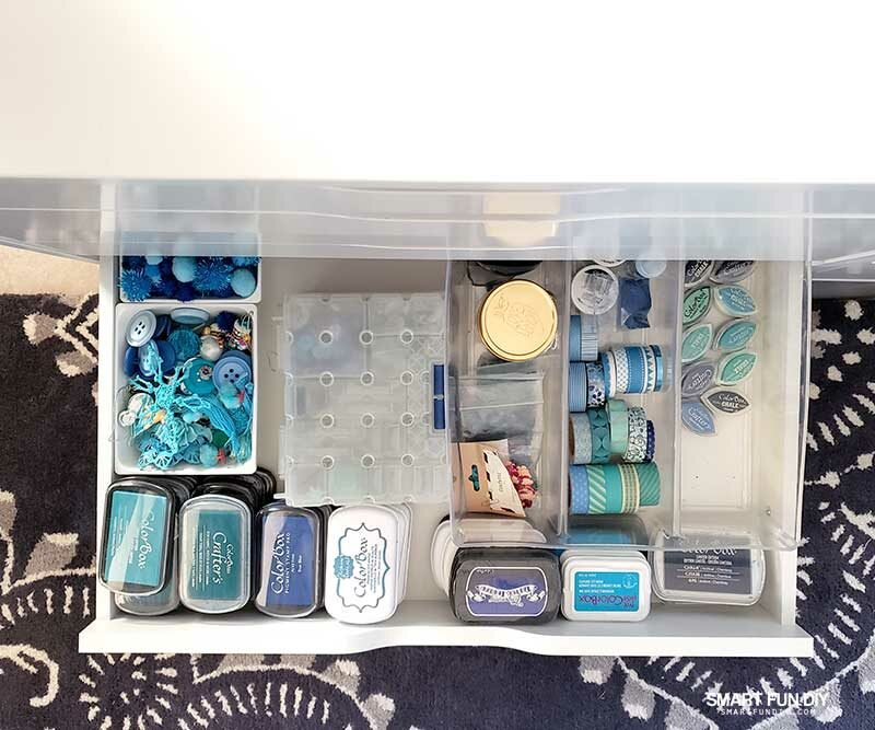 Open drawer in IKEA Alex drawer unit with blue craft supplies inside