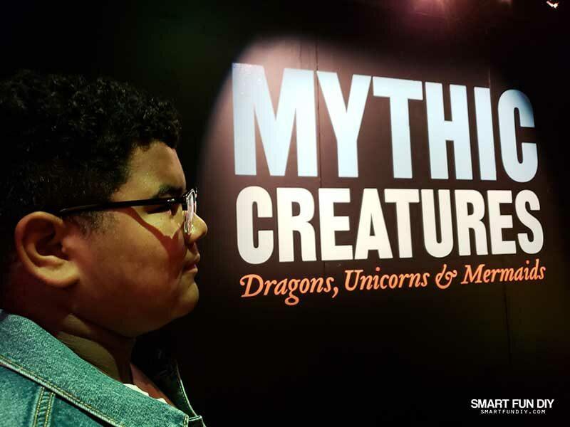 Boy at COSI Mythic Creatures Exhibit sign