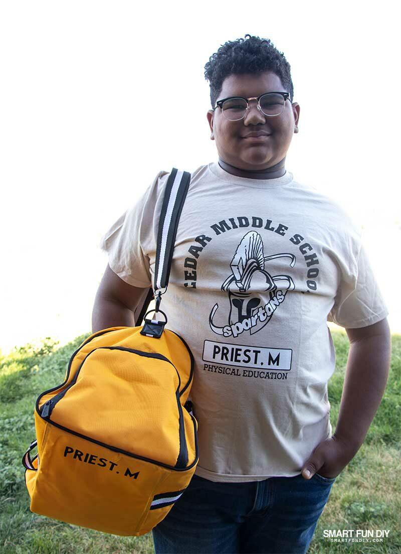 boy in gym uniform with gym bag